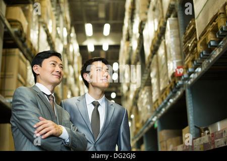 Happy businessmen in warehouse - Stock Photo