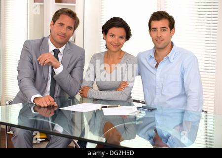 woman man businessman indoor desk contract - Stock Photo