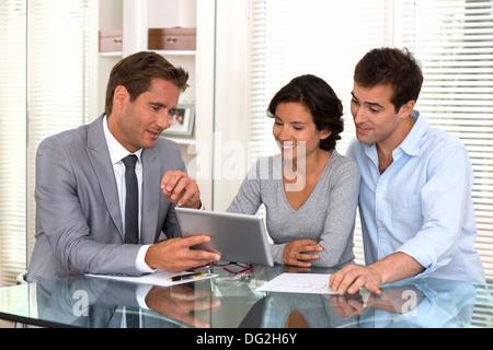 woman man businessman tablet pc indoor contrat - Stock Photo