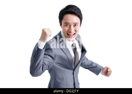 Excited businessman punching the air - Stock Photo