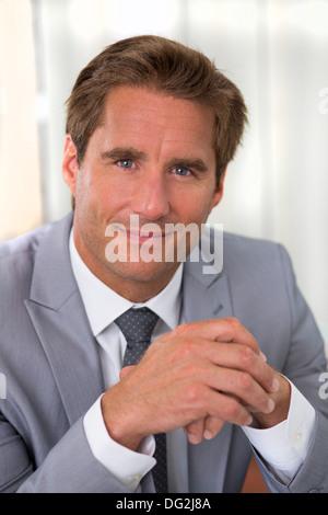 man indoor winner office contract - Stock Photo