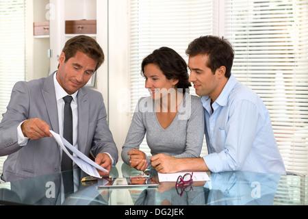 woman man businessman indoor contrat - Stock Photo