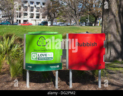 A red rubbish bin and a green recycling bin in Hagley Park, Christchurch, Canterbury, South Island, New Zealand - Stock Photo