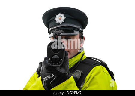 Police officer uses a Laser Technology Inc UltraLyte laser speed detector gun (front on, cutout) - Stock Photo