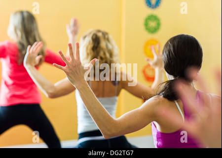 Three Women in Yoga Class, Rear View - Stock Photo