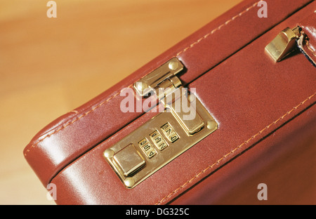 Combination lock on briefcase - Stock Photo