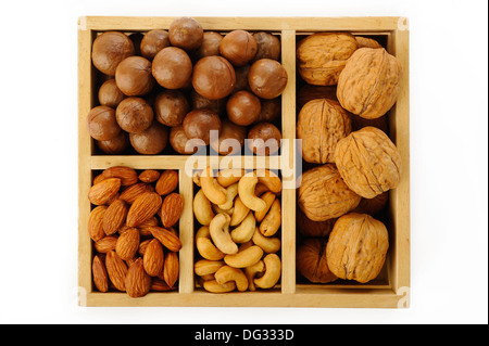 Assorted nuts in wooden box - Stock Photo