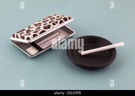 Roll ups and a retro style cigarette case - Stock Photo