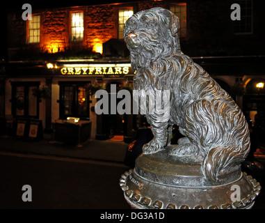 Greyfriars Bobby dog statue outside the pub of the same name Edinburgh Scotland UK at night - Stock Photo