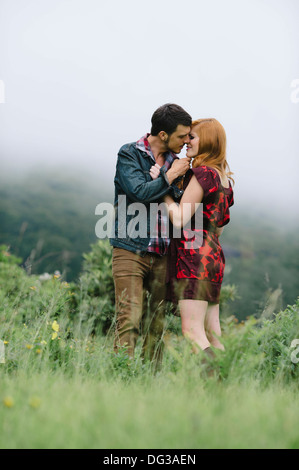 Romantic Couple About to Kiss in Foggy Field - Stock Photo