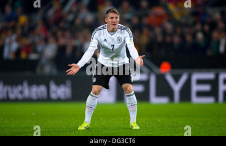 Cologne, Germany. 11th Oct, 2013. Germany's Bastian Schweinsteiger reacts during the soccer match between Germany - Stock Photo