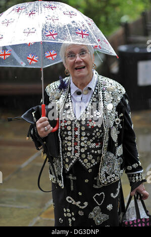 London, UK. 13th Oct, 2013. Peggy Scott, the Pearly Queen of Highgate arriving at the St Paul's Church Harvest Festival - Stock Photo