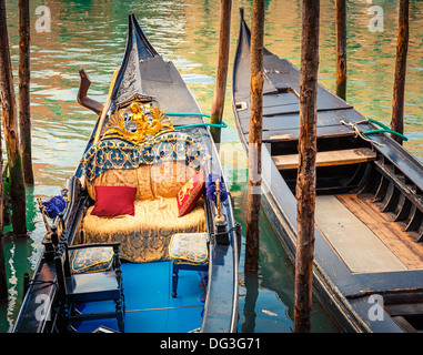 Gondolas on canal in Venice - Stock Photo