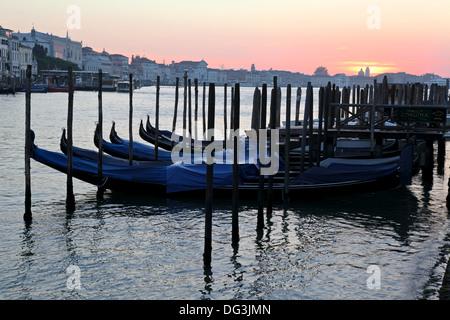 Gondolas on Grand Canal on sunrise - Stock Photo