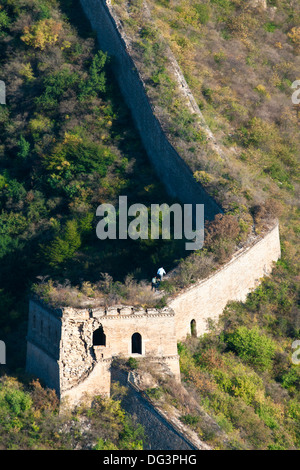 Hikers on a wild unrestored section of the Great Wall of China at Huanghua Cheng (Yellow Flower),  Huairou, China - Stock Photo