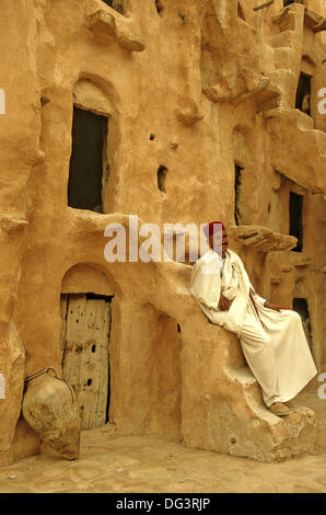 Tunisia, Tataouine, Ksar Ouled Soltane, fortified grainary, Tunisian caretaker of old site - Stock Photo