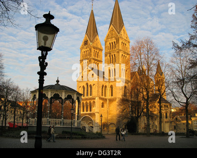 Munsterplein with band stand and Munsterkerk Roermond Netherlands in late afternoon sun - Stock Photo
