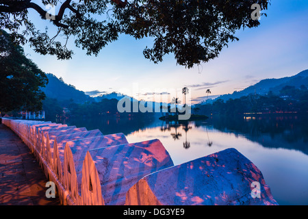 Kandy Lake and the island which houses the Royal Summer House at dawn, Kandy, Central Province, Sri Lanka, Asia - Stock Photo