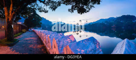 Kandy Lake and the Clouds Wall (Walakulu Wall) at sunrise, Kandy, Central Province, Sri Lanka, Asia - Stock Photo