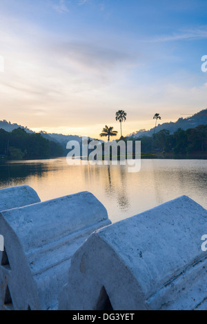 Kandy Lake at sunrise, the island of the Royal Summer House, with the Clouds Wall in the foreground, Kandy, Sri - Stock Photo