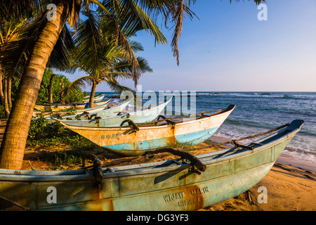 Traditional Sri Lanka fishing boats on Mirissa Beach, South Coast, Sri Lanka, Asia - Stock Photo