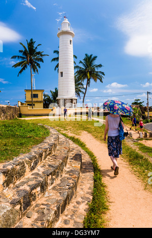 Tourist visiting Galle lighthouse in the Old Town of Galle, UNESCO World Heritage Site, Sri Lanka, Asia - Stock Photo