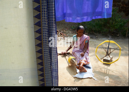 Woman working on silk weaving for sari production in a village around Jangipur, West Bengal, India, Asia - Stock Photo