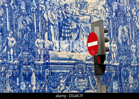 No entry sign in front of blue azulejo tiling covering wall of Capela das Almas, town centre, Porto, Portugal - Stock Photo