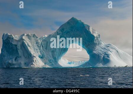 Natural Arch carved in an iceberg, Antarctic Sound, Antarctic Peninsula - Stock Photo