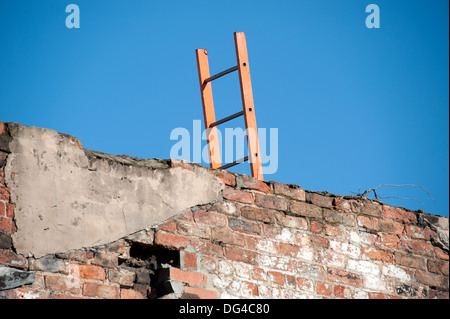 Ladder wall overcome climb over sky blue wooden - Stock Photo