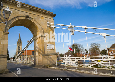 Marlow Suspension Bridge and All Saints Church by Thames river. Marlow. Buckinghamshire. England. UK. - Stock Photo