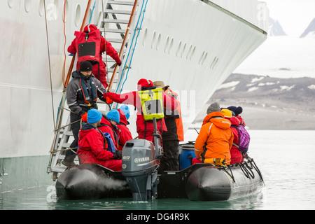 Passengers disembark Zodiaks onto the Russian research vessel, AkademiK Sergey Vavilov an ice strengthened ship - Stock Photo