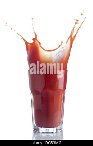 Tomato juice splash in a glass isolated on white - Stock Photo