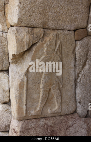 A bas relief stone carving of one of the Hittite kings from a tomb in Hattusa, Turkey. - Stock Photo