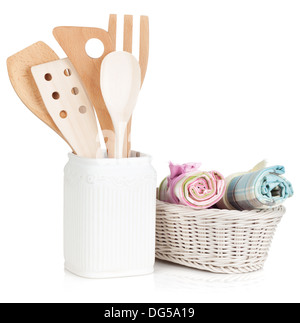 Kitchen utensils in holder and towels. Isolated on white background - Stock Photo