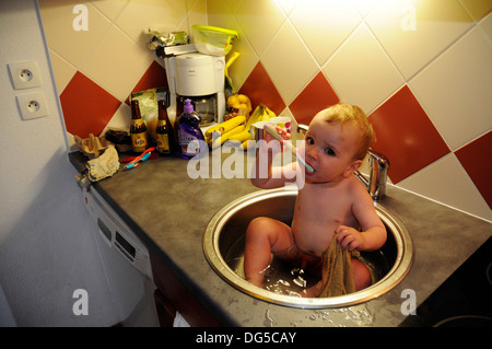 cute funny little boy bathing in galvanized tub outdoor in green stock photo royalty free image. Black Bedroom Furniture Sets. Home Design Ideas