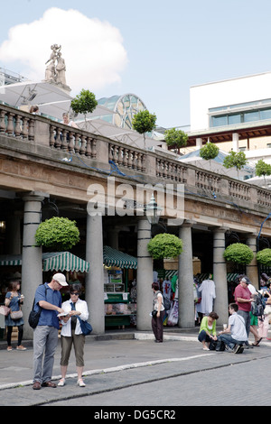 A lost couple reading a map in Covent Garden, London - Stock Photo