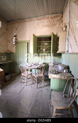 Kitchen in Abandoned House in Ghost Town - Stock Photo