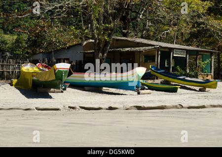 local caiçara fisherman canoe at Castelianos bay (baia de Castelhanos) Ilhabela, Sao Paulo state shore, Brazil - Stock Photo