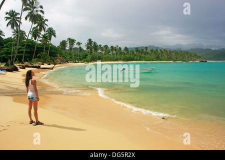 Young woman standing at Rincon beach, Samana peninsula, Dominican Republic - Stock Photo