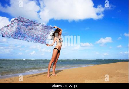 Young woman in bikini at Las Terrenas beach, Samana peninsula, Dominican Republic - Stock Photo