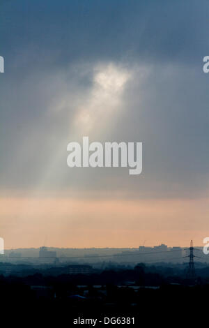 London, UK. 15th Oct, 2013. A beam of light breaks through the clouds shining down on Wimbledon town south west - Stock Photo