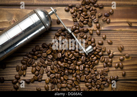 top view of metal grinder with coffee beans - Stock Photo