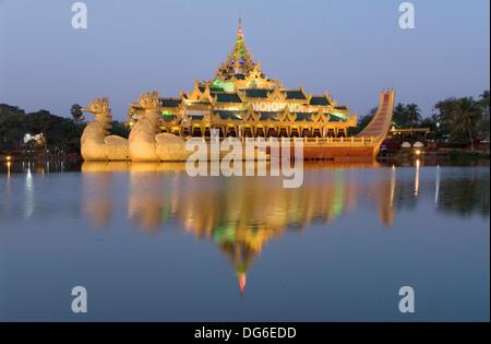 Karaweik barge in late evening, Kandawgyi Lake, Yangon (Rangoon), Myanmar (Burma) - Stock Photo