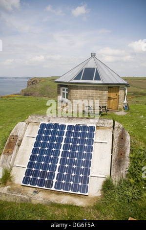 Solar panels converting sunshine into electricity for a small round house , part of the Druidstone Hotel on the - Stock Photo
