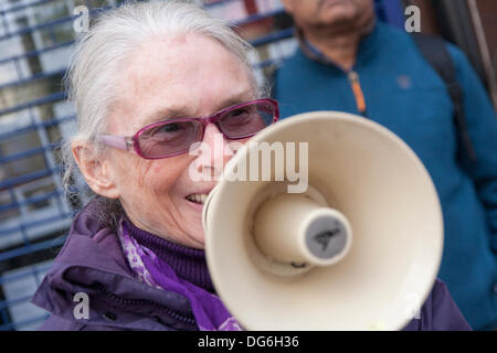 London, UK. 15th October 2013. An anti-racism campaigner demonstrates outside National Estate Agents in Willesden - Stock Photo