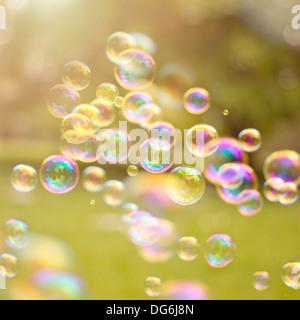 light bubbles drifting in a summer breeze. - Stock Photo