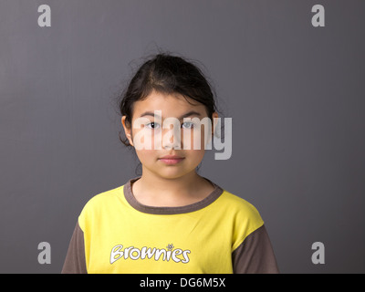 A portrait of a Brownie girl guide in uniform - Stock Photo