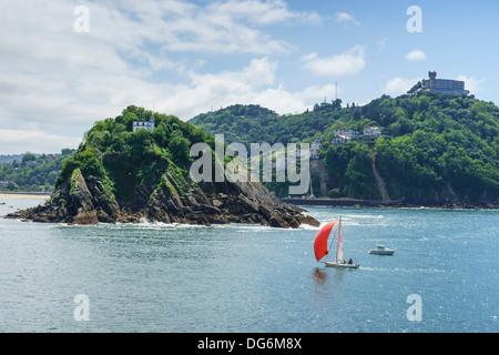 Basque country, Euskadi - San Sebastian. Yacht in the bay. - Stock Photo