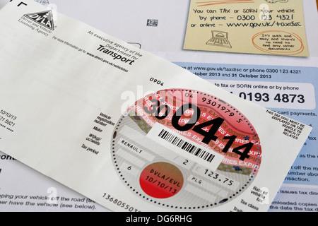 UK car tax disc and renewal form - Stock Photo